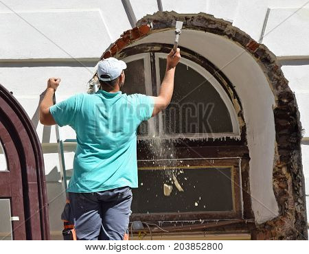 Construction worker at work outdoor in summer