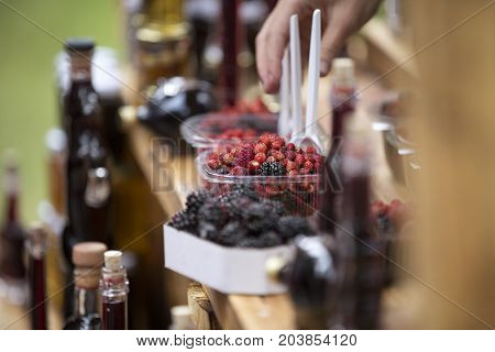 mixed fresh berries on a table for sale