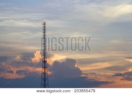Mobile phone communication tower transmission signal leash in evening sky