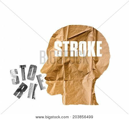 Crumpled paper shaped as a human head and STROKE concept on white background. STROKE concept.