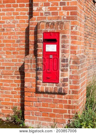 Close Up Of Red Royal Mail Box In Brick Wall Postage