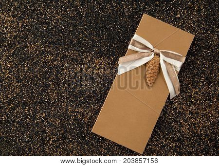 Booklet With A Christmas Tree Toy On The Sand