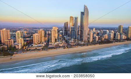GOLD COAST, AUSTRALIA - SEPTEMBER 3 2017: Aerial view of Surfers Paradise and famous coast line at sunrise.