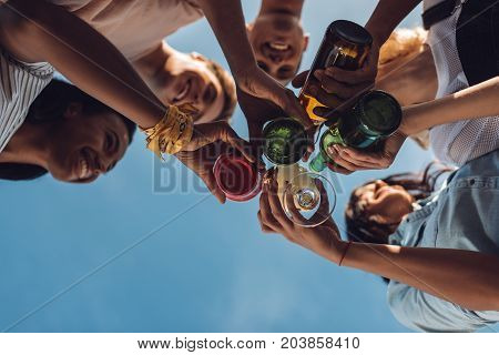 Friends Clinking Glasses And Bottles