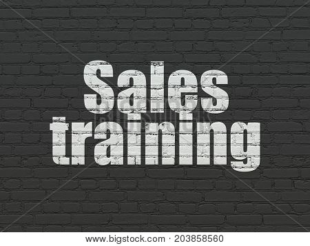 Advertising concept: Painted white text Sales Training on Black Brick wall background