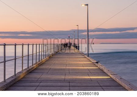 Rosebud Pier on the Mornington Peninsula south of Melbourne. Figures are motion blurred and unrecognisable.