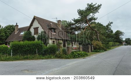 Country Houses With Green Fences And Streets In The Region Of Normandy, France. Beautiful Countrysid