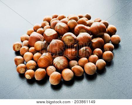 Hazelnuts on the black background. Shallow dof.