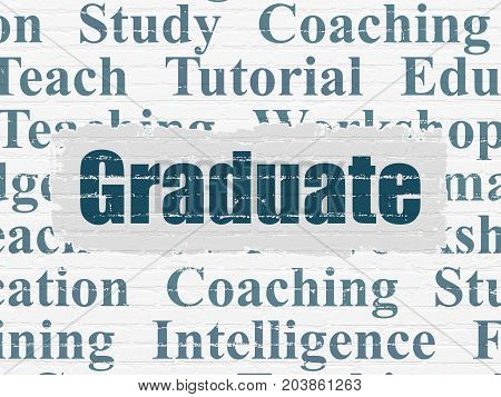 Learning concept: Painted blue text Graduate on White Brick wall background with  Tag Cloud