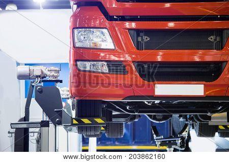 Truck on a column lift in a car service