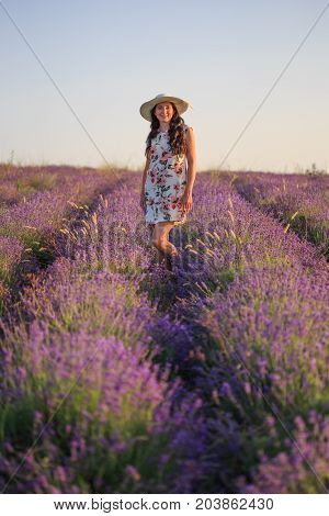 Romantic Woman Among Blooming Lavender