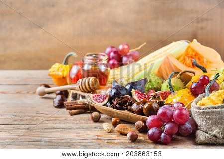 Fall Autumn Harvest Background With Pumpkin Apple Chestnut Corn