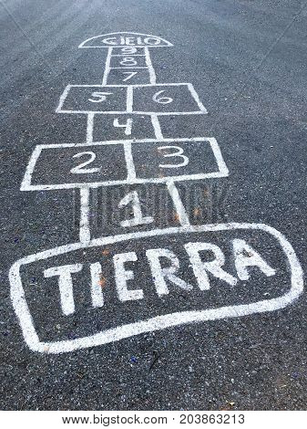 Hopscotch on the street, playing hopscotch outdoor