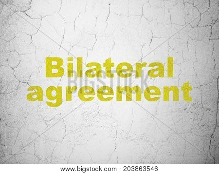 Insurance concept: Yellow Bilateral Agreement on textured concrete wall background