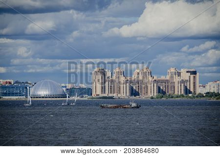 Apartment blocks and dome along the coastline of Saint Petersburg Russia