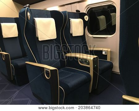 Nagano Japan, 13 February 2016: Shinkansen Japanese high-speed train green class seats and interior