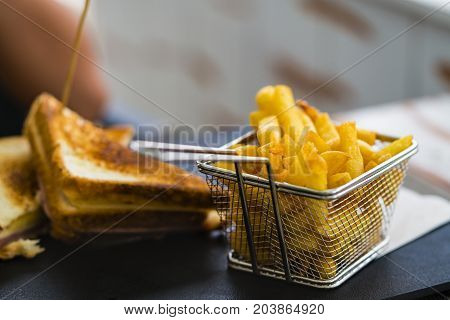 French fries golden color in a metal basket