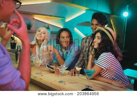 Multicultural Friends With Drinks In Bar