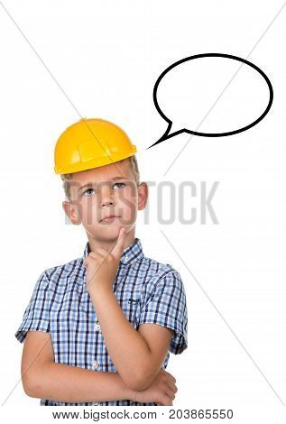 Thoughtful cute teenager in a builder helmet has an idea. Isolated on white background