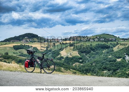 Summer landscape along the road from Maranello to Serramazzoni (Modena Emilia Romagna Italy) at summer with bicycle