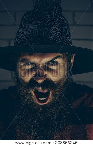 Halloween Hipster Shouting With Anger In Wizard Hat