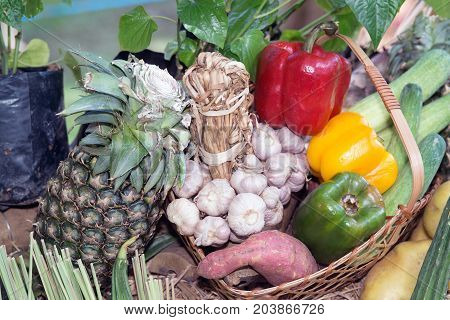 Mixed fresh colorful vegetables and fruits showing on table.