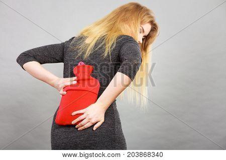 Girl Having Back Pain, Holding Hot Water Bottle