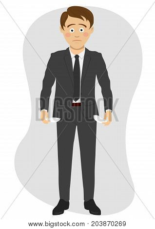 Young unhappy businessman shows his empty pockets over white background