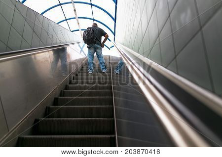 Warsaw, Poland - August 2, 2017: A Man Climbs The Escalator From The Metro.