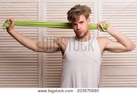 Guy With Messy Hair And Serious Face On Wooden Background
