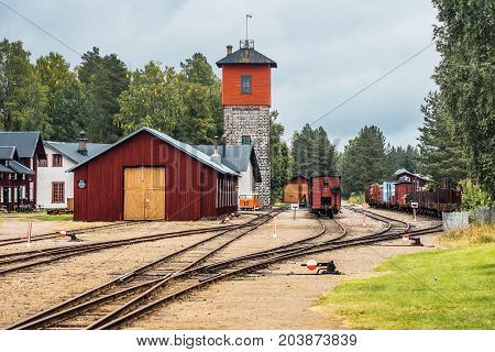 Old train station with several tracks shifts and a loading tower. Located in a small town on the Swedish countryside