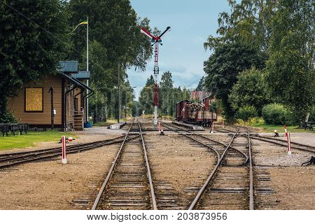 Old vintage train station with several tracks and shifts . Located in a small town Sweden