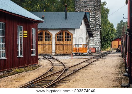 Old railroad service station and garage for maintenance of wagons and locomotives located in a small countryside town in Sweden