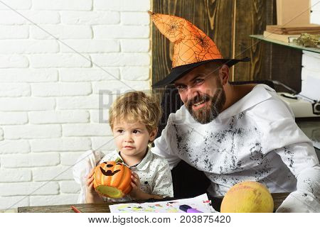 Man And Boy On White Brick Wall Background