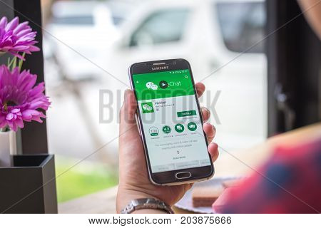 Chiang Mai, Thailand - September 12, 2017: Samsung Galaxy S6 smartphone launches wechat application on the desk screen at the coffee shop.