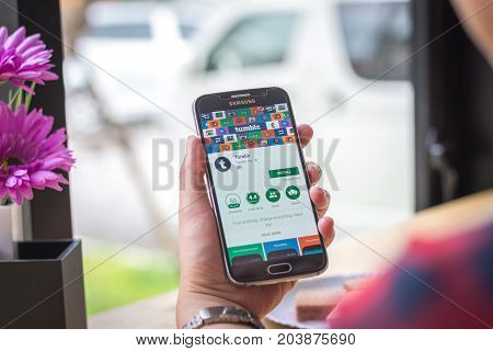 Chiang Mai, Thailand - September 12, 2017: Samsung Galaxy S6 smartphone launches tumblr application on the desk screen at the coffee shop.