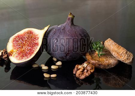 Figs, Dried Figs, Half Of Fig, Walnut And Pine Nuts On Black Background.