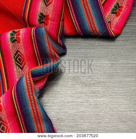 Color pattern tablecloth on wooden table for background. Fabric texture. Wooden texture.Template for designers
