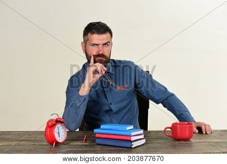 Man With Beard Holds Glasses Isolated On White Background