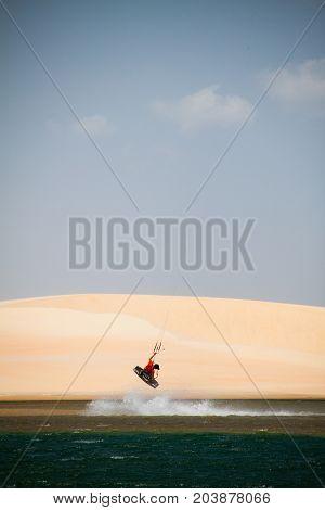 Windsurfer on a remote beach in Brazil