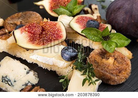Overhead Of Figs, Dried Figs, Snack Sandviches With Brie, Blue Cheese, Fig Slices, Pine Nuts And Blu