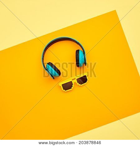 Minimal. Music vibration. Headphones and Trendy fashion Sunglasses. Hipster DJ Accessories Set. Bright Art Creative Style. Sweet color. Top view