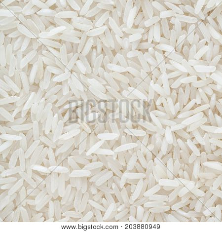 Close up of uncooked white long grain rice background