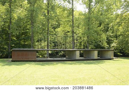 OLOT, SPAIN - JULY 28, 2017: Bathing Pavilion designed by RCR architects located in Olot the capital city of the comarca of Garrotxa in the Province of Girona Catalonia Spain.