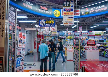 TOKYO, JAPAN JUNE 28 - 2017: Unidentified people in the enter of Yodobashi Camera department store. Yodobashi Camera is a chain store mainly selling electronic products with 21 stores in Japan.