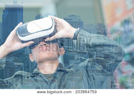 Students boy wearing playing virtual reality goggles in modern coworking studio. Smartphone using with VR headset. (VR) is computer technology that uses Virtual realities headsets