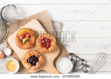 Danish Bread With Fruits, Blueberry And Cherry Sauce