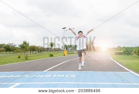 Happy Asian Fat Boy Running To The Finished Line.