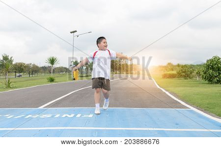 Happy Asian Fat Boy Running To The Finished Line.,