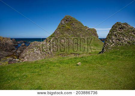 Beautiful landscape, green hills of Ireland at Ballintoy sea shore